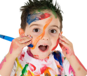 Child with paint all over his face